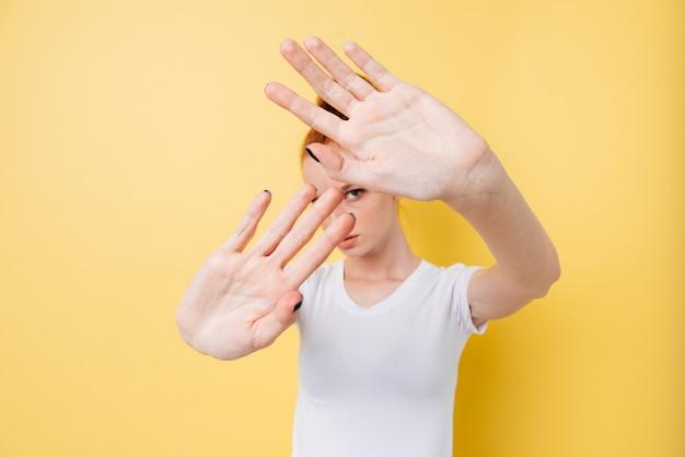Ginger woman doing stop gesture, no photos