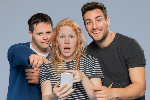 Ginger woman looking shocked next to friends