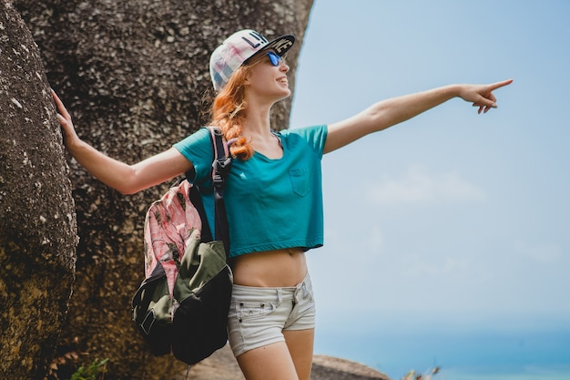 Ginger woman traveling in mountains, tourist on summer vacation