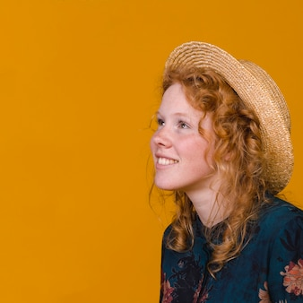 Ginger young woman smiling and looking away