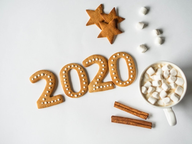 Gingerbread 2020 new year ginger cookies and chocolate mug with marshmallows