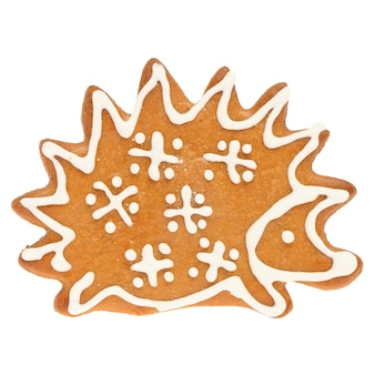 Gingerbread christmas cookie hedgehog isolated on white wall