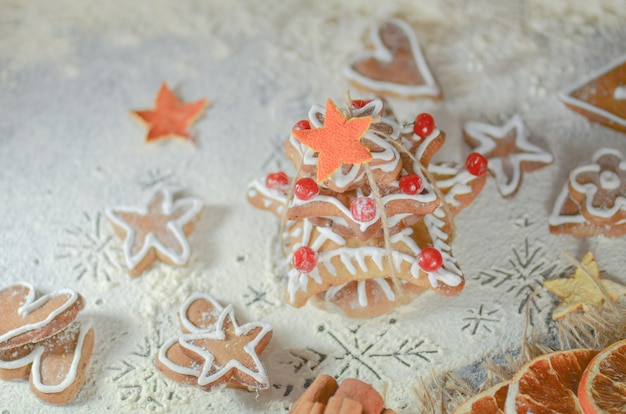 Gingerbread christmas tree on wooden table,