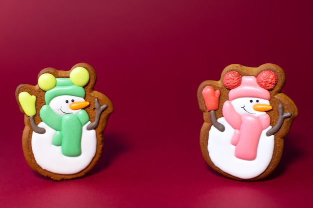 Gingerbread cookie of cute snowman on red