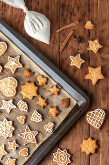 Gingerbread cookie icing on a baking sheet.