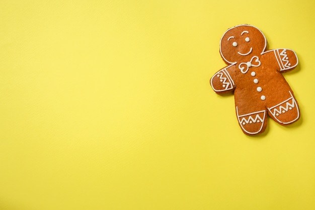 Gingerbread cookie man on yellow background