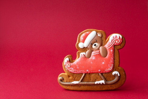 Gingerbread cookie of teddy bear on sleigh