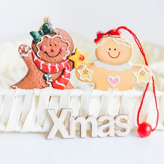Gingerbread cookies in the basket with xmas text on white background