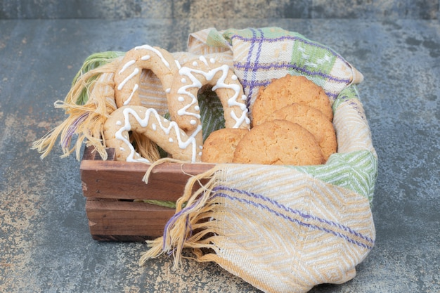 Gingerbread cookies and biscuits in wooden basket. high quality photo
