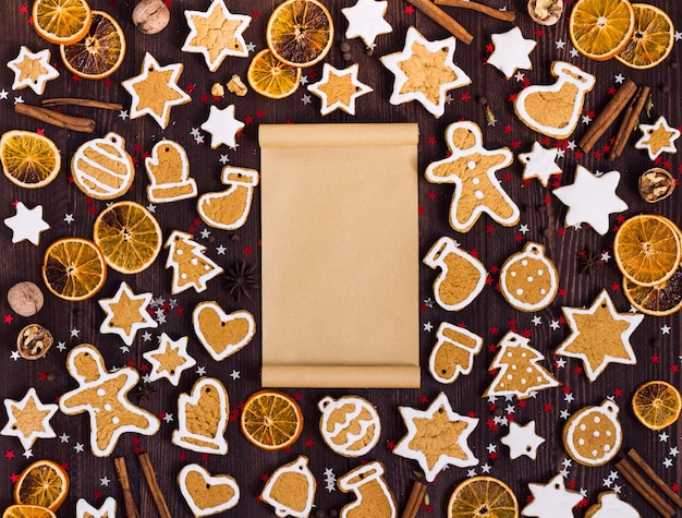 Gingerbread cookies christmas empty paper for recipe new year oranges cinnamon