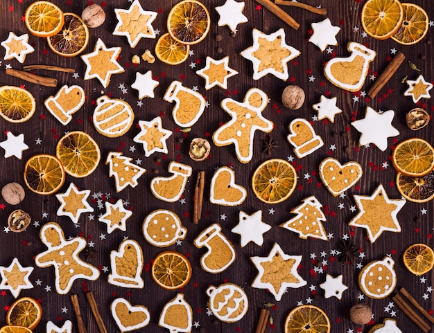Gingerbread cookies christmas new year oranges cinnamon on wooden table