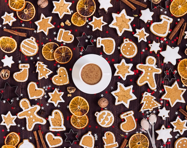 Gingerbread cookies cup of coffee christmas drink new year oranges cinnamon