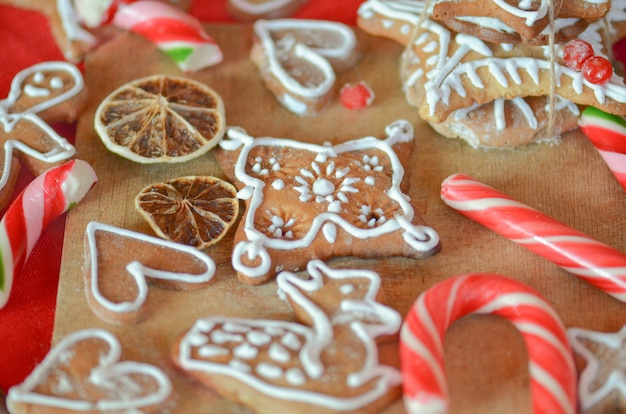 Gingerbread cookies, dried oranges, spices and christmas lights