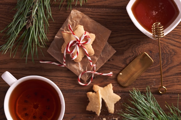 Gingerbread cookies and hot tea with lemon and honey