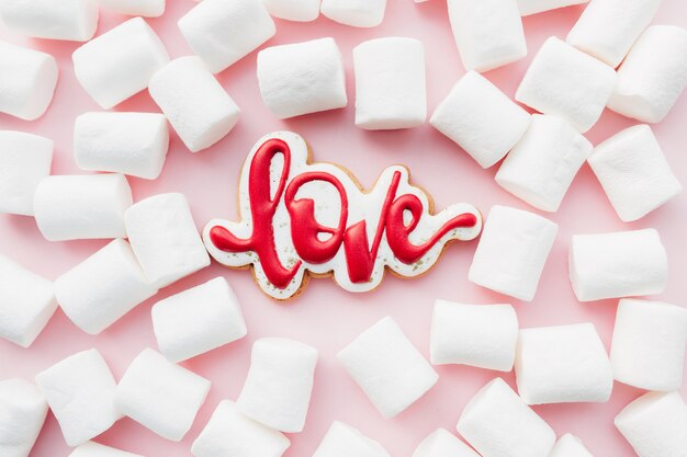 Gingerbread cookies love with white marshmallow. valentine card. pink background. high quality photo