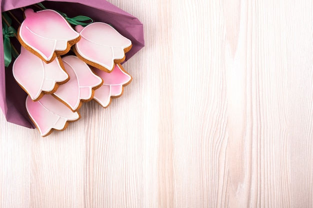 Gingerbread cookies in the shape tulips on wooden table