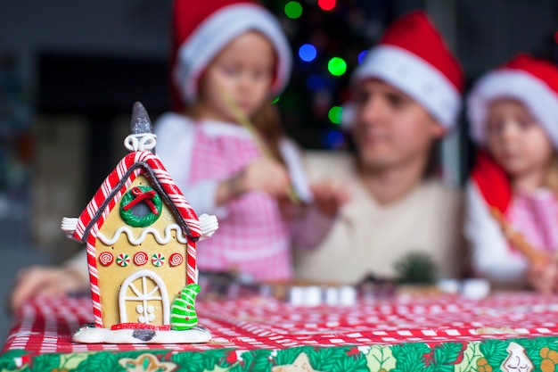 Gingerbread fairy house decorated by colorful candies
