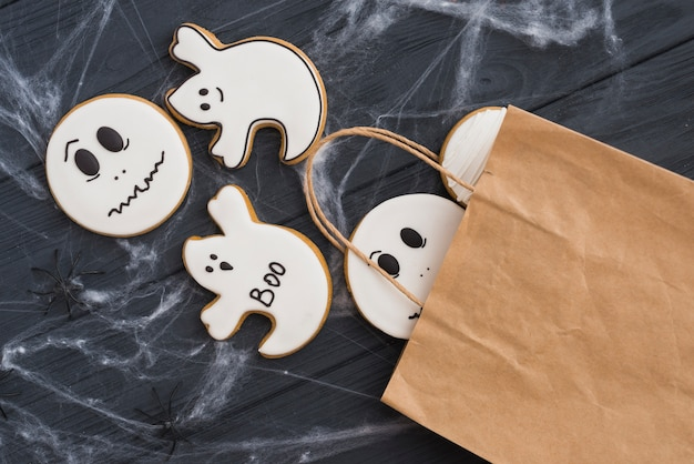 Gingerbread falling out of bag in cobweb