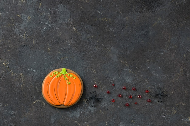 Gingerbread in the form of a pumpkin handmade and two black spiders