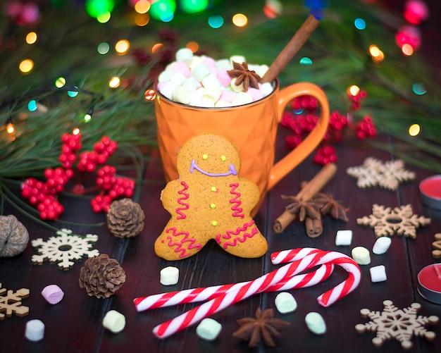 Gingerbread, hot chocolate, cinnamon, cloves on wooden table happy new year, merry christm