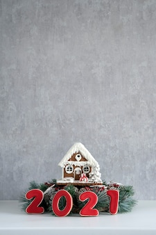Gingerbread house and inscription 2021. merry christmas background, copy space.