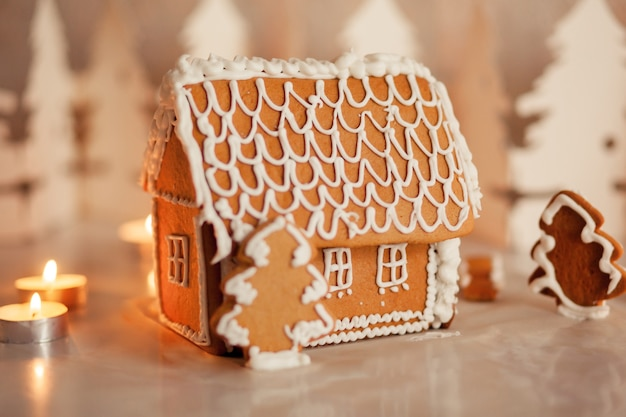 Gingerbread house on the table in a bright living room
