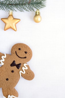 Gingerbread man cookie and fir tree decorate with ornament