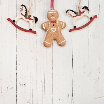 Gingerbread man with wood horses and copy space on the bottom
