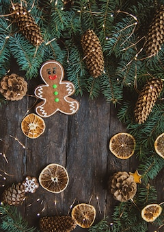Gingerbread men laying on wood background.