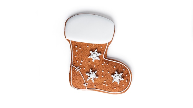 Gingerbread in the shape of a boot on a white background. high quality photo