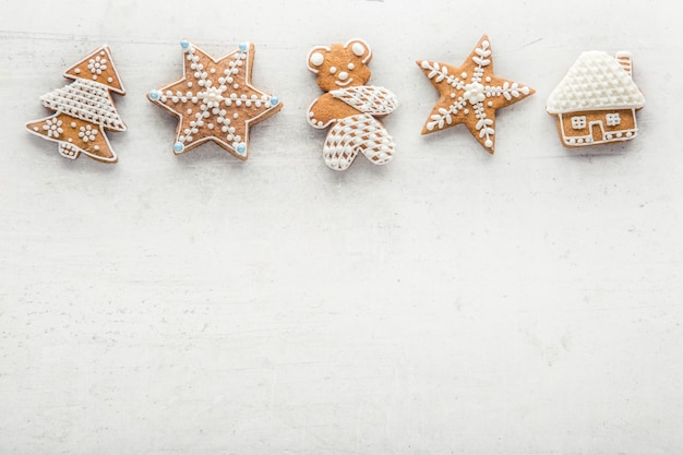 Gingerbread on white concrete background. top of view.