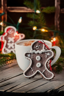 Gingerbread with cup of coffee on a wooden table