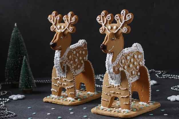 Gingerbreads deer on dark background, treat on christmas or noel holiday, horizontal format