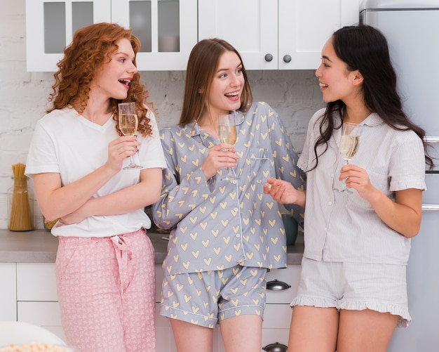 Girfriends having a drink at pijama party