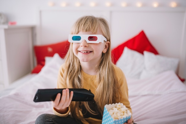 Girl in 3d glasses watching tv