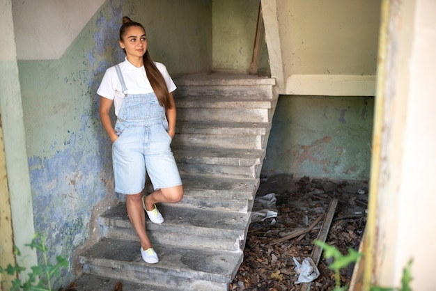 Girl in an abandoned house with long hair. hight quality photo