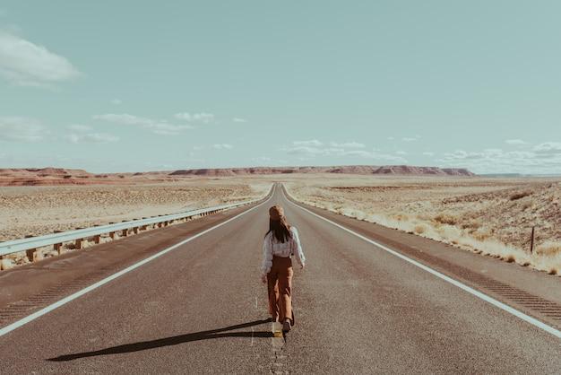 Girl alone walking on road