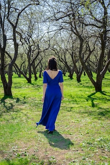 Girl in an apple orchard