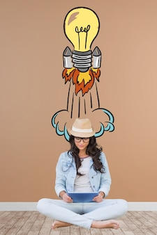 Girl artist with a hand drawn rocket bulb
