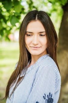 A girl of asian appearance in a city park. summer portrait of young tatar