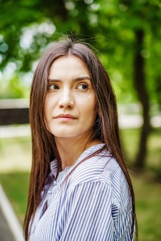 A girl of asian appearance in a city park summer portrait of young tatar