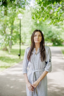 Girl of asian appearance on walk in city park. summer portrait of young tatar