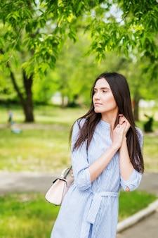 Girl of asian appearance on walk in city park summer portrait