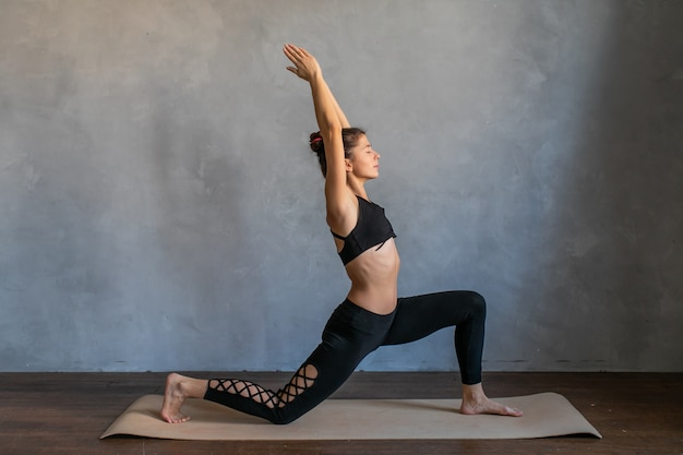 .girl balancing, practice stretch exercise at yoga class.