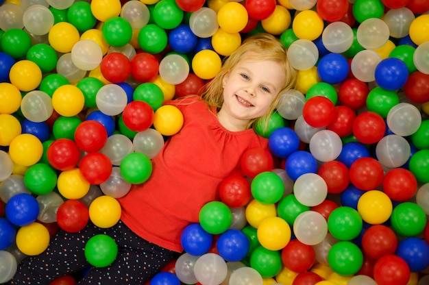 Girl in ball pit top view