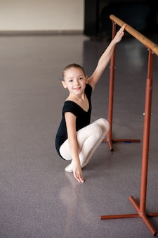 A girl at a ballet lesson