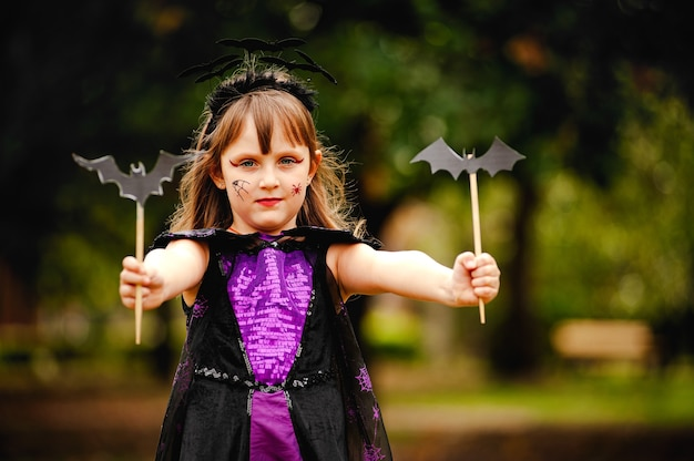Girl in bat costume for halloween