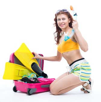 The girl in a bathing suit and mask for diving on white background