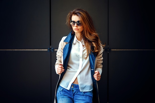 Girl in a beige coat and blue jeans