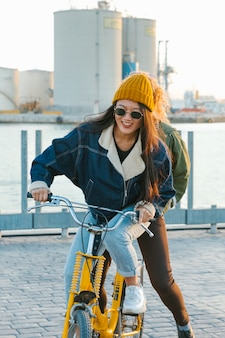Girl on bike in harbor